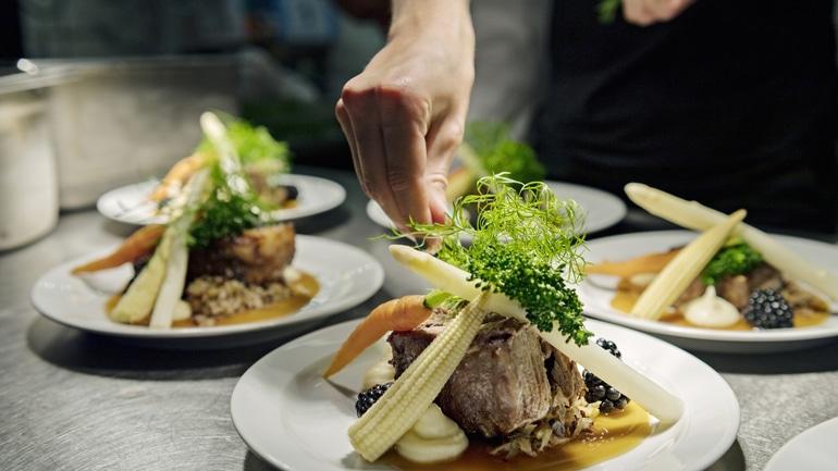 Professional chef plating food